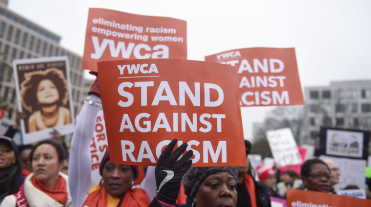 Women holding YWCA signs