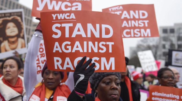 Women holding YWCA signs