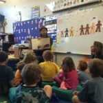 RER volunteer reading to students