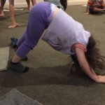 Child doing yoga at Children's Alley
