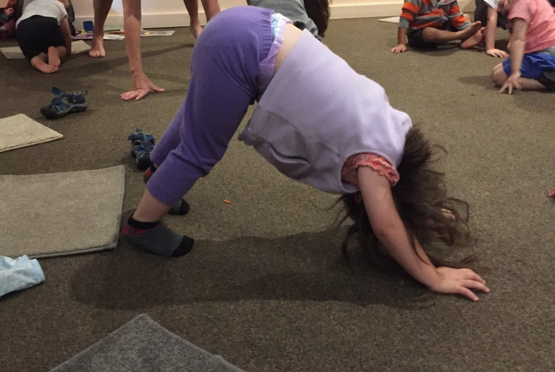 Child doing yoga at Children's Alley