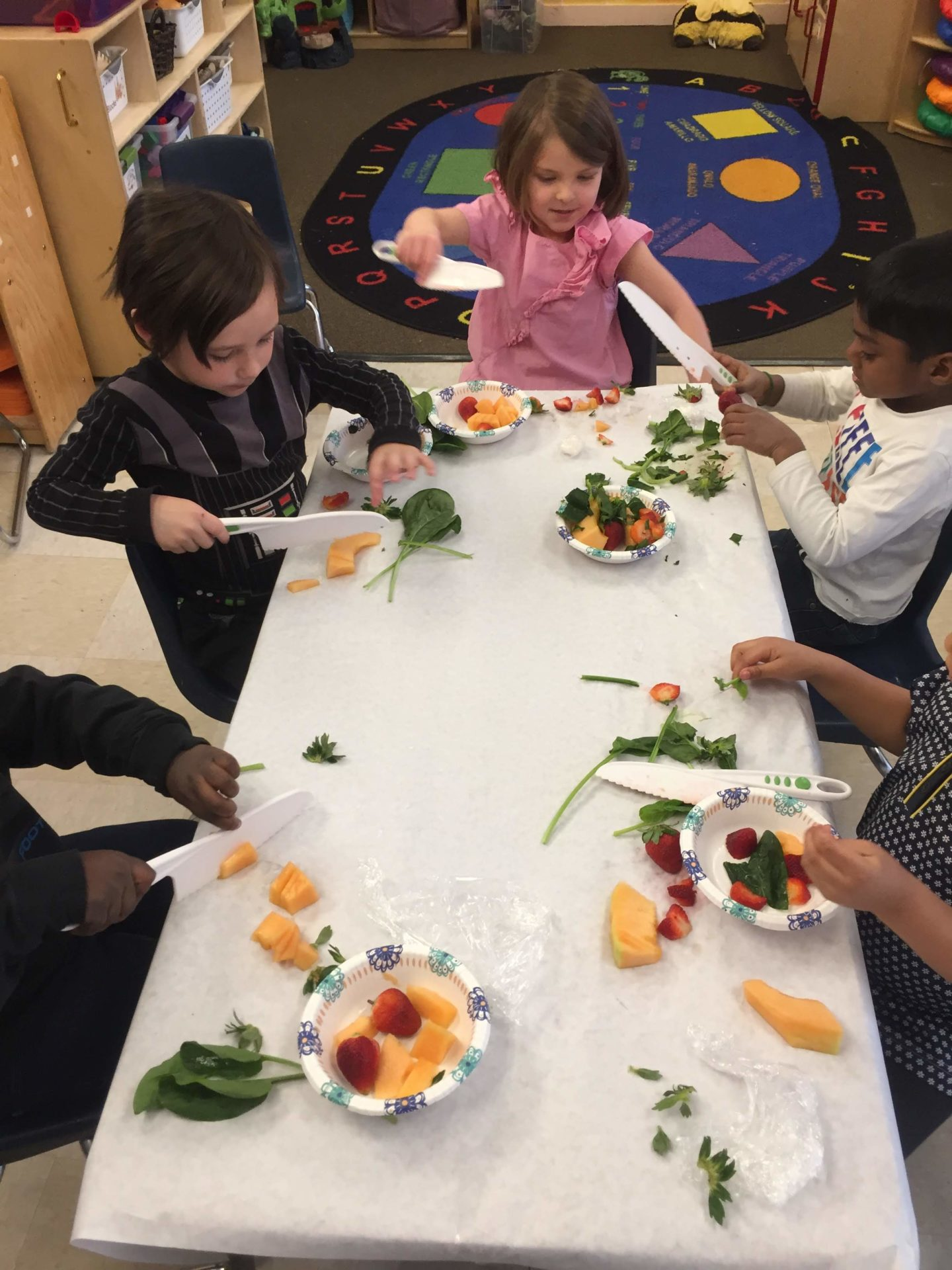 Children helping to prepare a nutritious meal at Children's Alley
