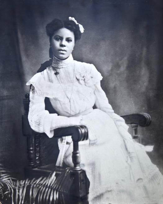 Young Black woman in white dress and corsage