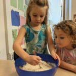 Children stirring batter for zucchini bread