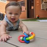 Smiling infant in outdoor play area